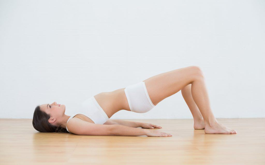 woman doing bridge pose