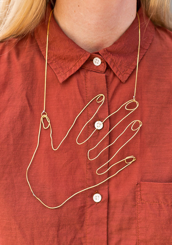 wire hand necklace